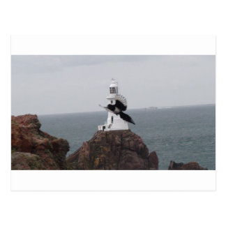 Magpie flying past La Corbiere Lighthouse Postcard