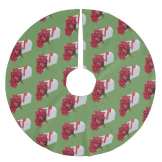 Mailbox filled with artificial poinsettias and red brushed polyester tree skirt