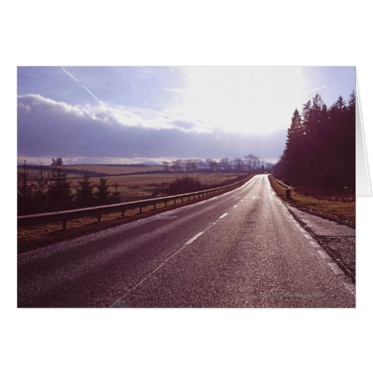 Main road with low winter sun. card