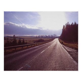 Main road with low winter sun. poster