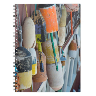 Maine, Bar Harbor. Colorful lobster trap buoys Notebook