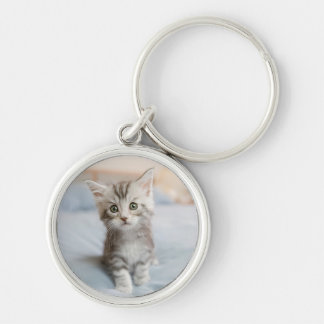 Maine Coon Kitten Sitting On Bed Keychain