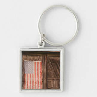 Maine, Faded American flag on door of old barn Keychain