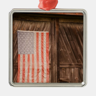 Maine, Faded American flag on door of old barn Metal Ornament