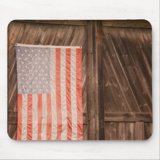 Maine, Faded American flag on door of old barn Mouse Pad