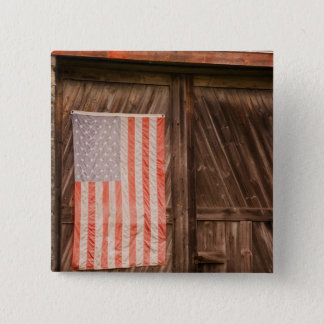 Maine, Faded American flag on door of old barn Pinback Button
