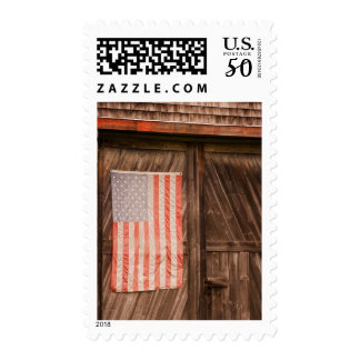 Maine, Faded American flag on door of old barn Postage