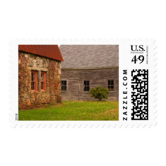 Maine,  Old stone building and wooden barn in Postage