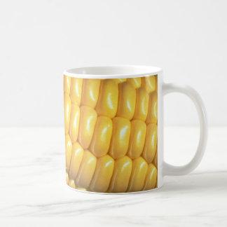 Maíz en la mazorca taza de café