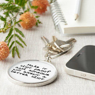 Make it idiot proof and someone will invent... Silver-Colored round keychain