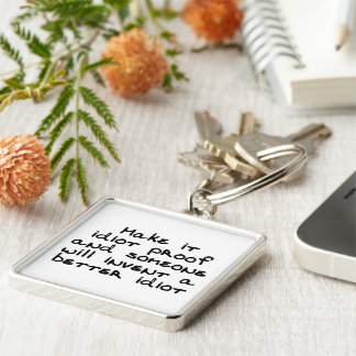 Make it idiot proof and someone will invent... Silver-Colored square keychain