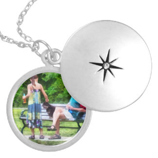 Making a New Friend in the Park Round Locket Necklace