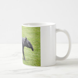 Malayan tapir walking on grass coffee mug