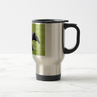 Malayan tapir walking on grass travel mug