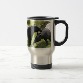 Malayan tapirs on grass travel mug