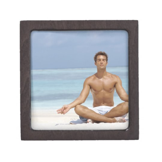 Maldives, Handsome young man meditating in a Jewelry Box