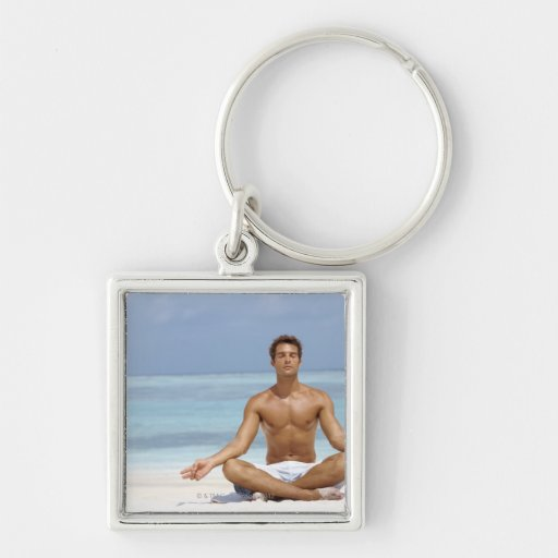Maldives, Handsome young man meditating in a Keychain