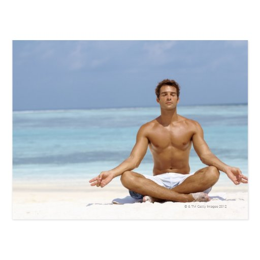 Maldives, Handsome young man meditating in a Postcard