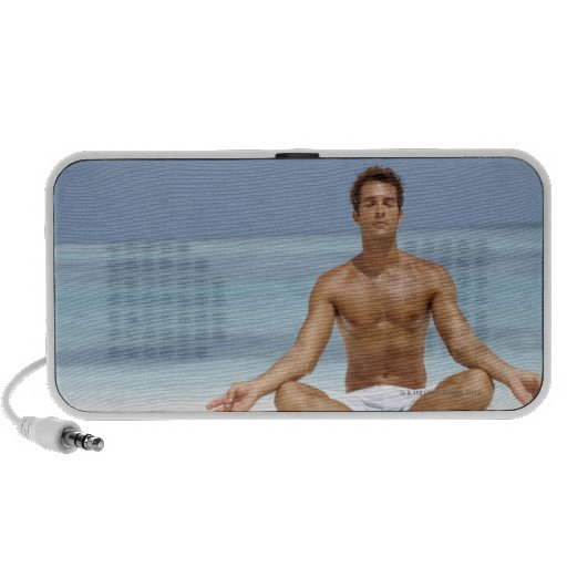 Maldives, Handsome young man meditating in a Portable Speakers