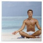 Maldives, Handsome young man meditating in a Ceramic Tile