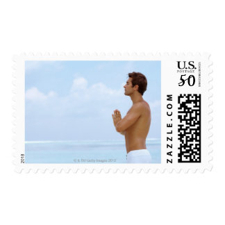 Maldives, Smart young guy practicing yoga at Postage