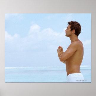 Maldives, Smart young guy practicing yoga at Poster