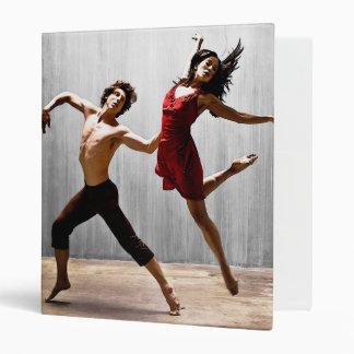 Male and Female Modern Dancers in Red Dress Binders