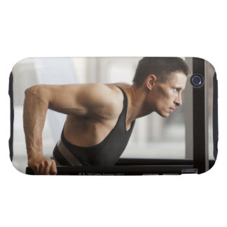 Male athlete using gymnastics equipment in gym tough iPhone 3 case