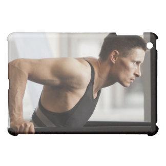 Male athlete using gymnastics equipment in gym iPad mini cover