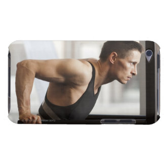 Male athlete using gymnastics equipment in gym iPod touch case