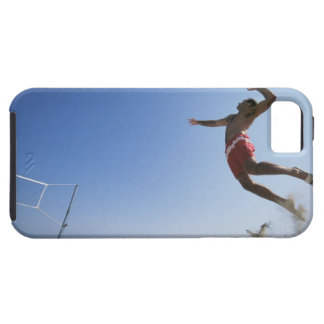 Male beach volleyball player jumping up to spike iPhone 5 covers