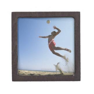Male beach volleyball player jumping up to spike keepsake box