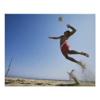 Male beach volleyball player jumping up to spike print