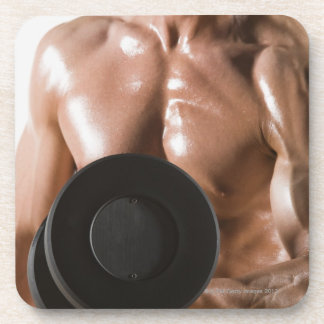 Male body builder flexing lifting weight drink coaster