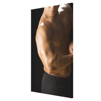 Male bodybuilder flexing muscles, front view, 2 canvas print