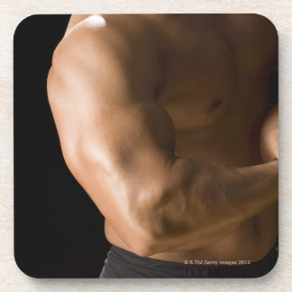 Male bodybuilder flexing muscles, front view, 2 coaster