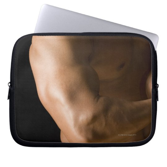 Male bodybuilder flexing muscles, front view, 2 laptop computer sleeve