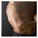 Male bodybuilder flexing muscles, front view, 2 large square tile