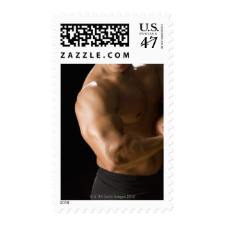 Male bodybuilder flexing muscles, front view, 2 stamp