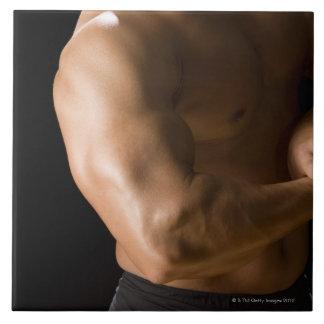 Male bodybuilder flexing muscles, front view, 2 tile