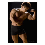 Male bodybuilder flexing muscles, front view, greeting card