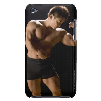Male bodybuilder flexing muscles, front view, iPod touch cover