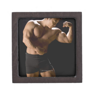Male bodybuilder flexing muscles, front view, jewelry box