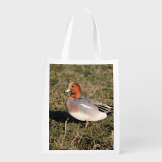 male Eurasian Wigeon Duck walks in a grassy field Reusable Grocery Bag
