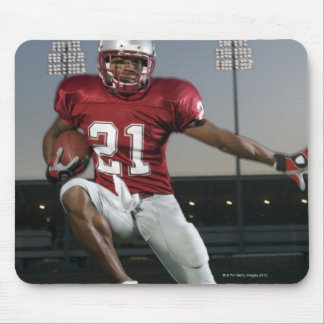 Male football player carrying football mouse pad