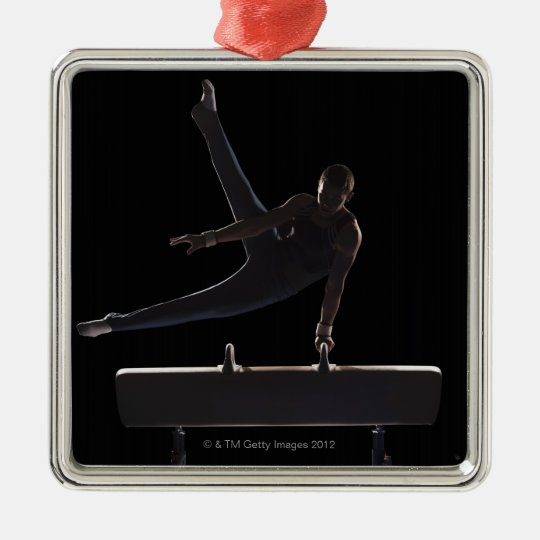 Male gymnast on pommel horse metal ornament