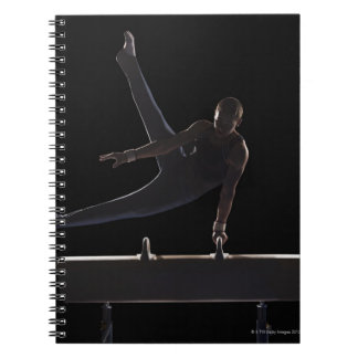 Male gymnast on pommel horse notebook