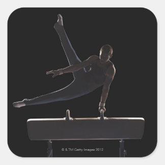 Male gymnast on pommel horse square sticker