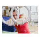 Male gymnast on rings postcard