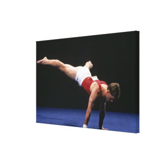 Male gymnast peforming a routine in the floor canvas print